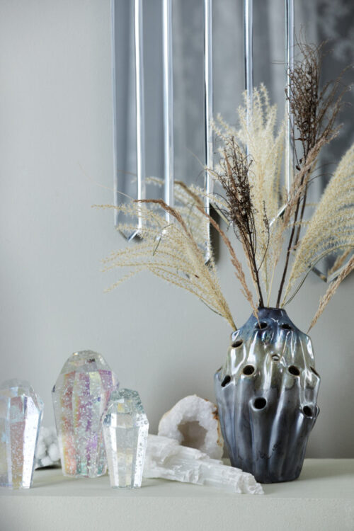 Styling photo of blue Lava Vase, Repeat Mirror and Crystal Rocks